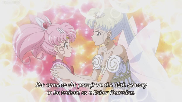"A pink-haired girl (Sailor Chibi-Moon) and a white-haired woman (Neo-Queen Serenity). The woman is wearing a white dress with ornamental wings. They're surrounded by pastel colours and sparkles. Text: ""She came to the past from the 30th century to be trained as a Sailor Guardian."""
