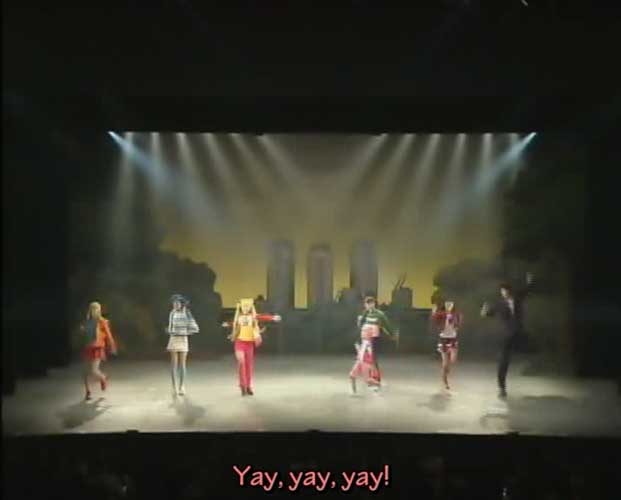 Usagi, Chibiusa, Mamoru and the Inners all on stage singing a song during the revision of the Infinity Academy Mistress Labyrinth musical.