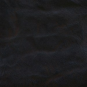 Spindled rustic goatskin, hand-dyed and antiqued to a dark brown finish