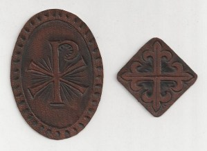 Two of our hand-tooled cross designs, ready to apply to your Bible's cover.