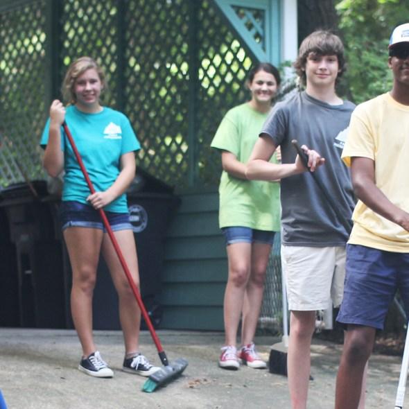 Volunteers in backyard