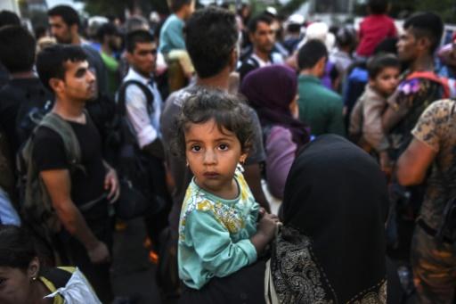 Des migrants à leur arrivée le 26 août 2015 à Presevo en Serbie © ARMEND NIMANI AFP