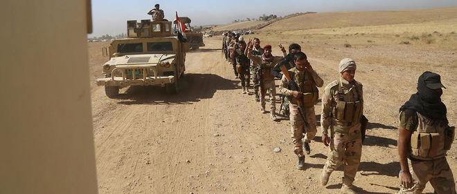 Les soldats de l'armée irakienne dans leur progression vers Mossoul. Eux seuls devraient entrer dans la ville, à dominante sunnite. Mais cette armée nationale reste composée majoritairement de chiites.