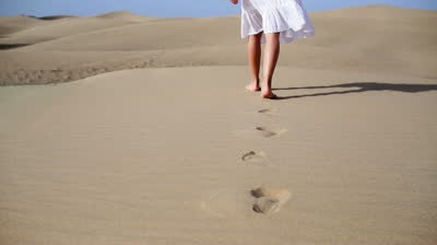 stock-footage-woman-feet-walking-on-the-desert