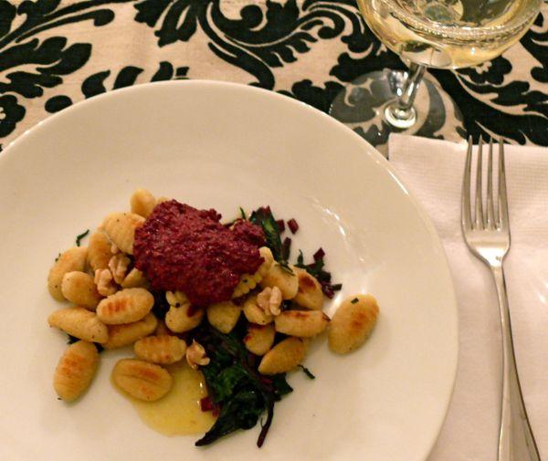 gnocchi, beet greens and pesto on orange butter sauce