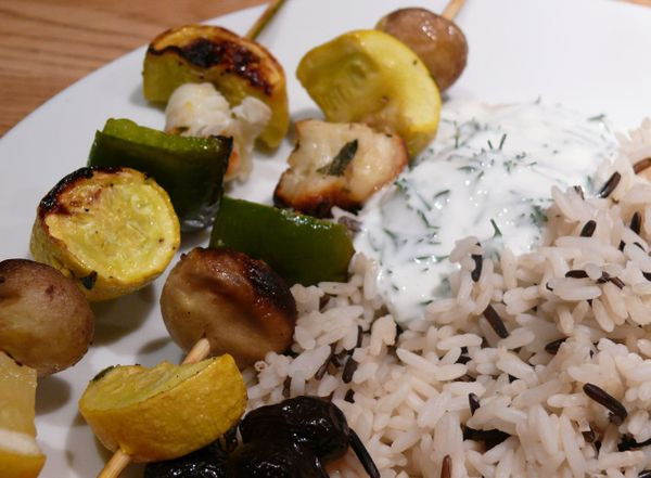 veg halloumi kebabs on wild rice with dill yogurt and black olives