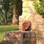 Visage sculpté dans le jardin du saulies