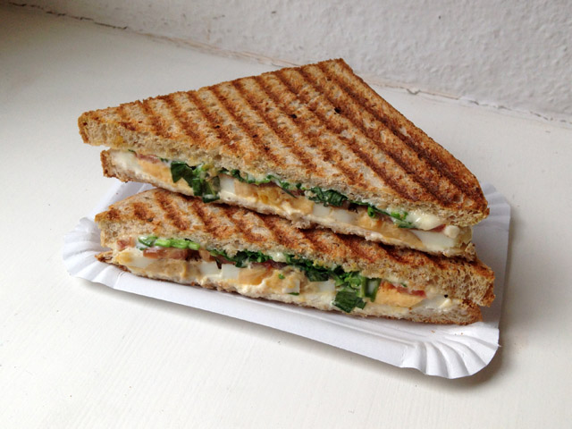 Grilled sandwich with green herb filling