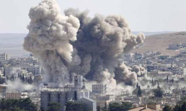 Smoke rises after an US-led air strike in the syrian town of Kobani