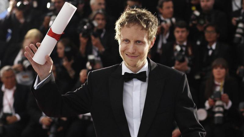Director Laszlo Nemes holds the Grand Prix award for the film Son of Saul during a photo call following the awards ceremony at the 68th international film festival, Cannes, southern France, Sunday, May 24, 2015. (AP Photo/Thibault Camus)