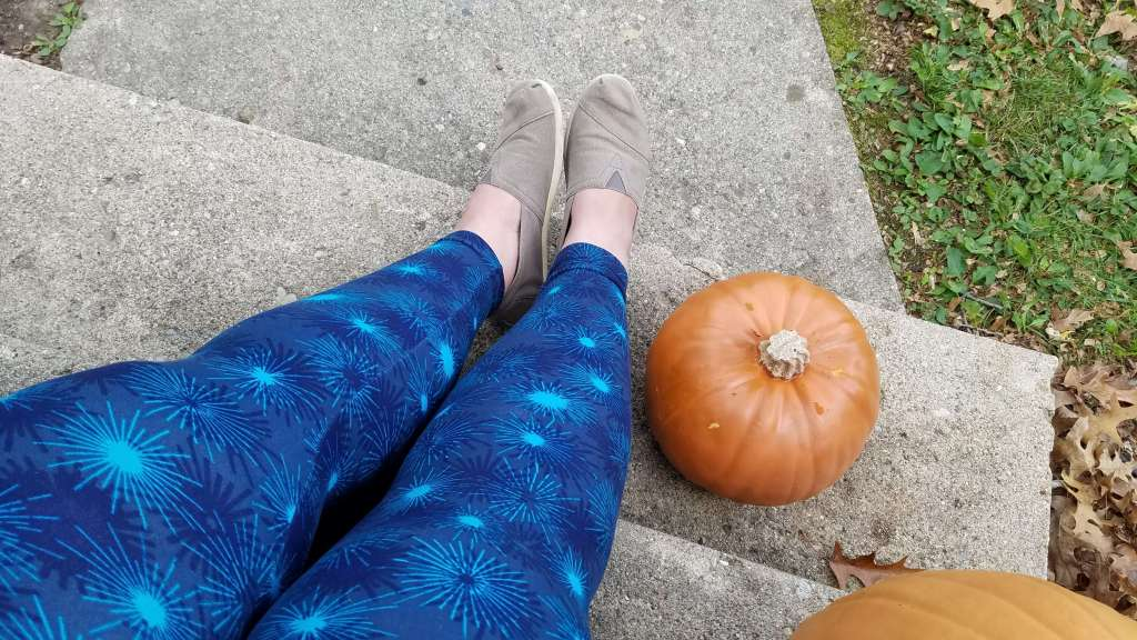 Wearing blue firework Lularoe leggings