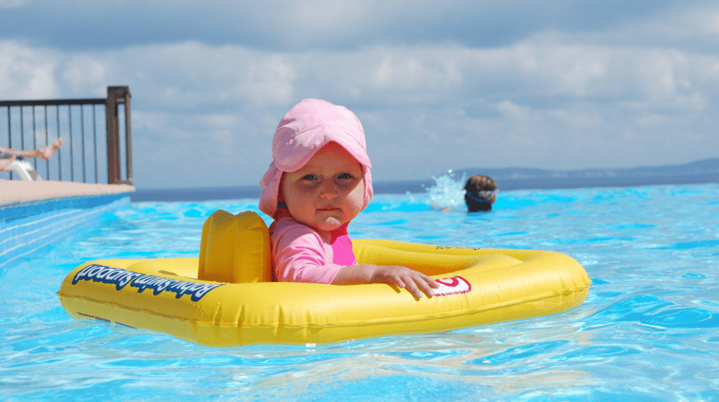 Spring Break with Kids Prep Guide - baby in pool image