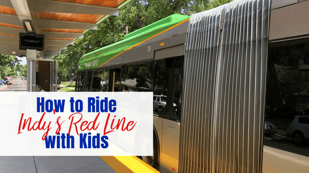 """Bus parked at station platform with text overlay """"How to Ride Indy's Red Line with Kids"""""""