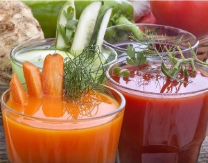 Healthy vegetable juices of carrot cucumber beetroot and tomato