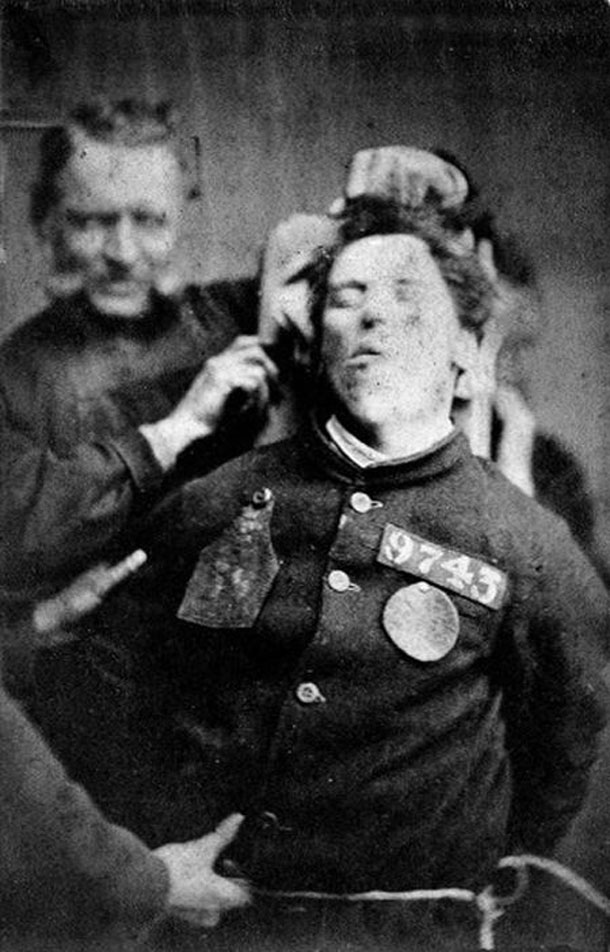 An-insane-asylum-patient-restrained-by-warders-Yorkshire-1869-Henry-Clarke