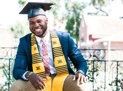 A photo of a smiling graduate with a graduation cap and tassel. Photo by nappy from Pexels.
