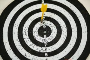 An image of a dart striking close to the bullseye on a dart board, illustrating the importance of writing a target resume as a resume trend for 2021. Photo by Engin Akyurt from Pexels.