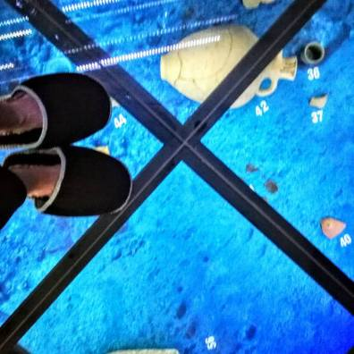In the archaeological section, the 2000-year-old Roman amphorae beneath the glass floor can be seen.