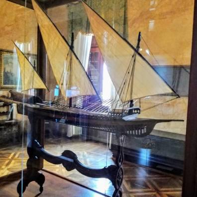 The antique model ship.
