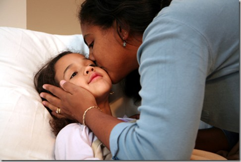 Mom Tucking Child into Bed