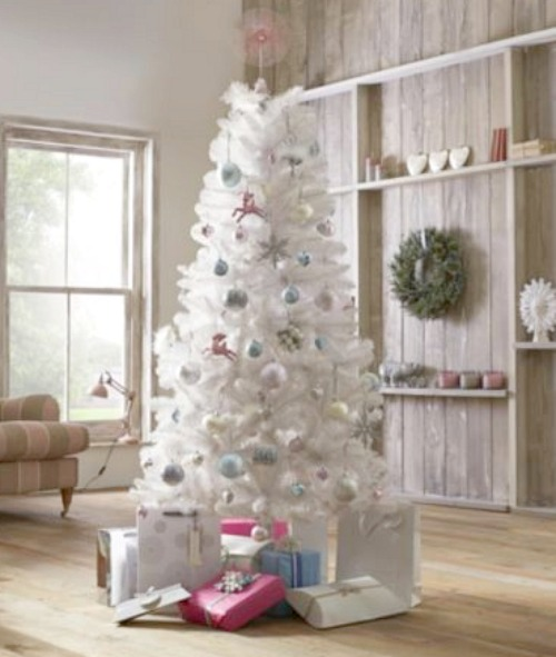A white Christmas tree with pastel tree decorations