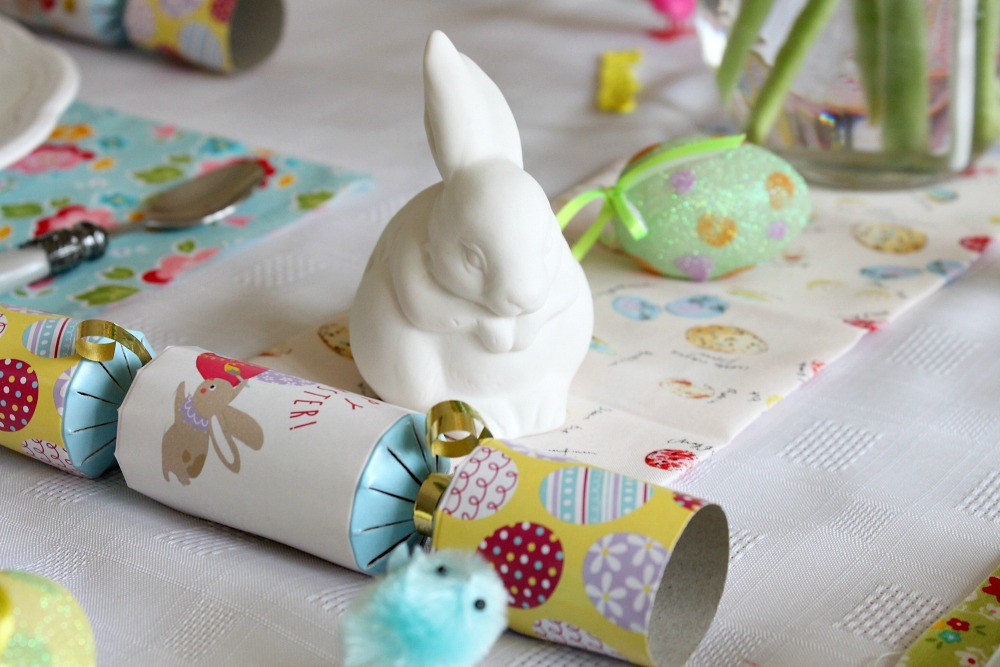 Easter table decorations with a white bunny, Easter crackers decorative eggs and chicks