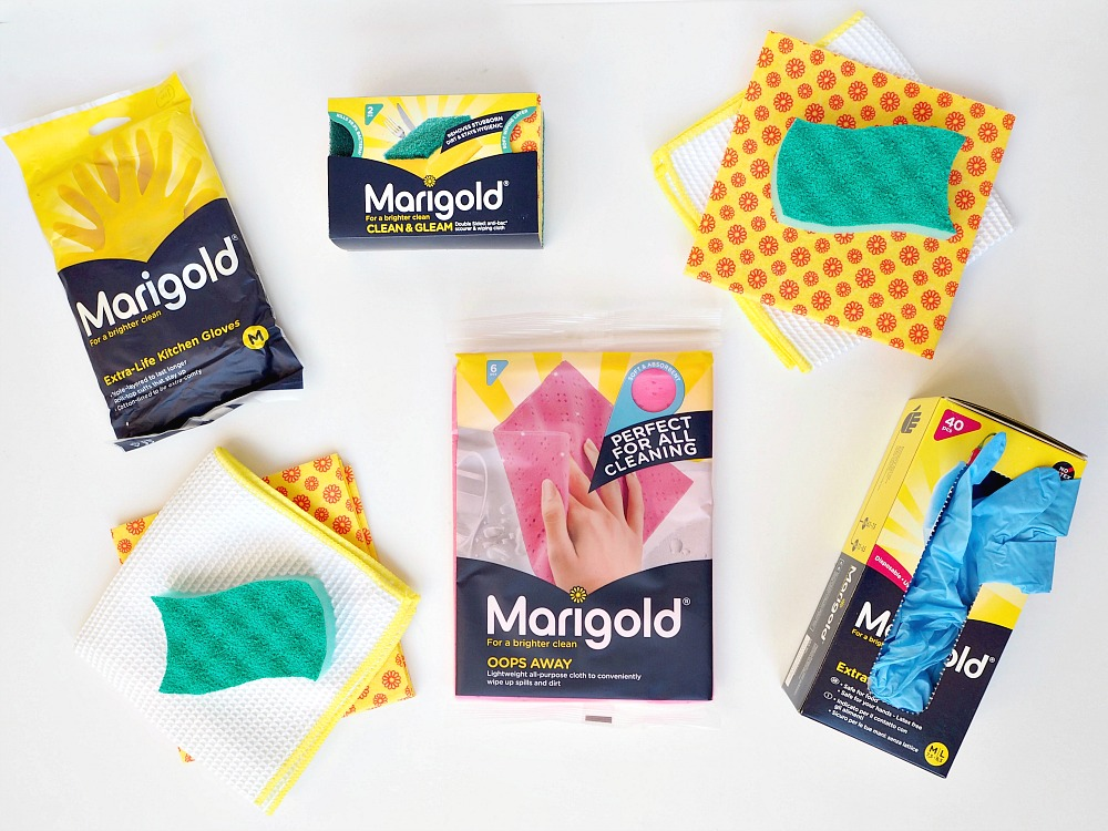 A selection of Marigold cleaning supplies, including gloves, clothes and sponges