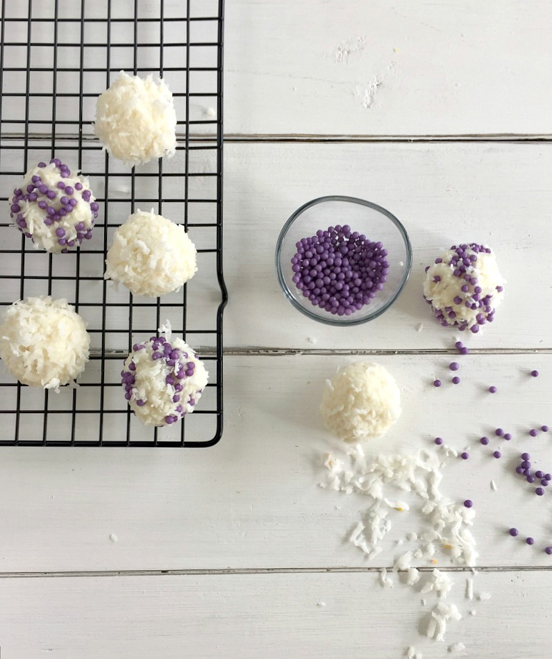 White coconut snowballs rolled in purple sprinkles