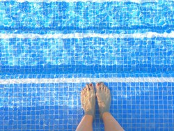 my foot in pool water