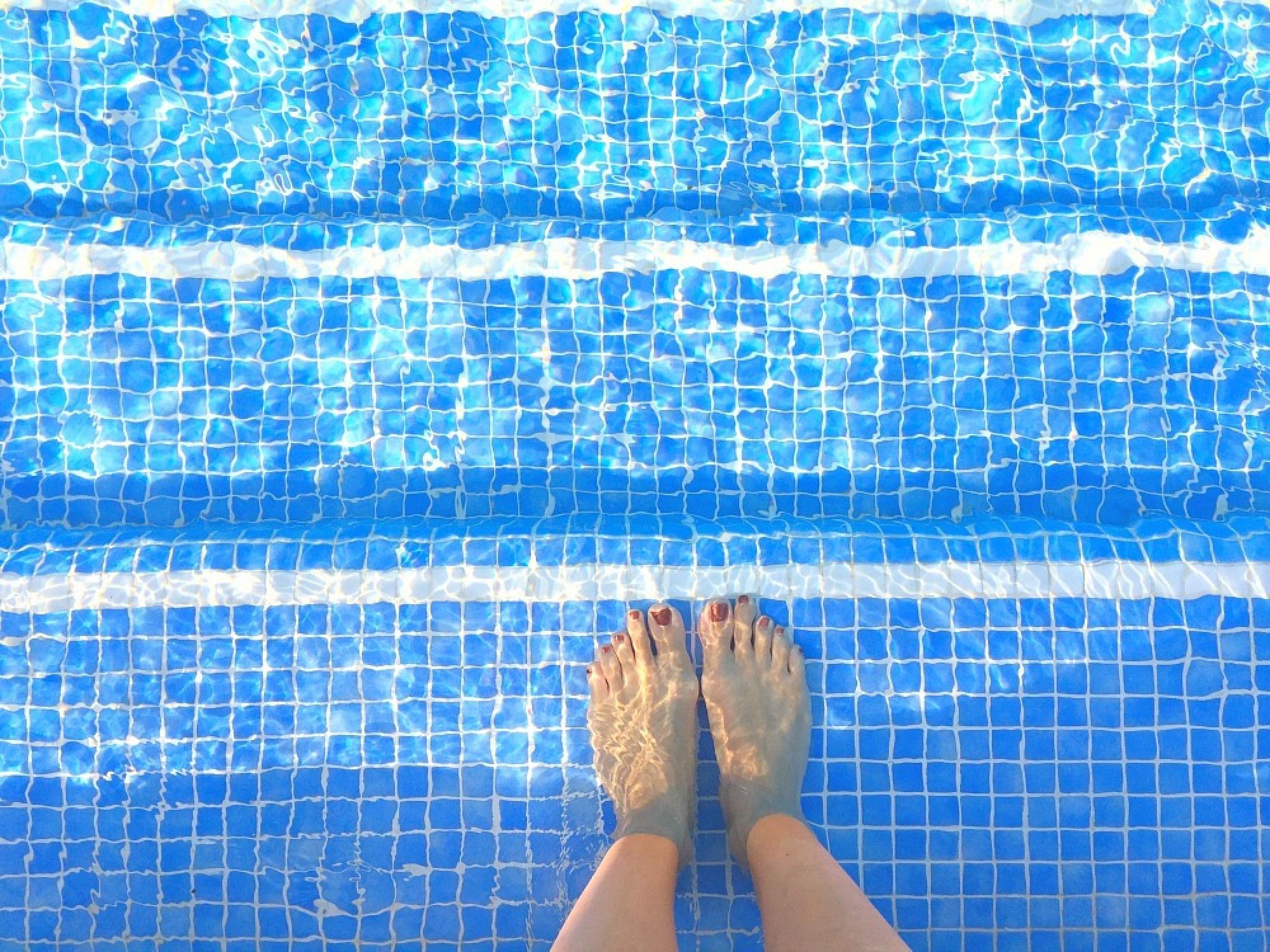 my foot in pool water