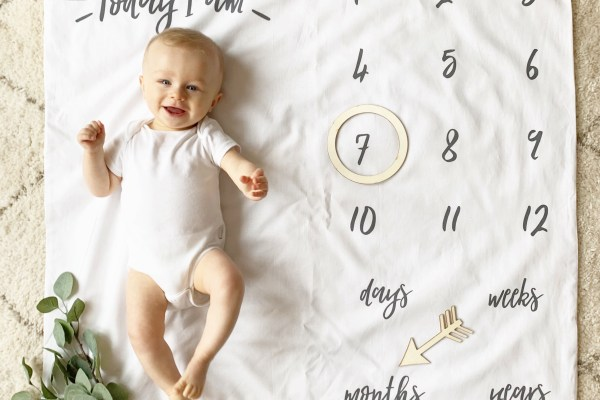 baby boy is 7 months old ginger ray milestone mat