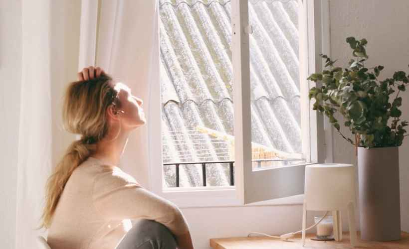 feng shui in your home and office woman sitting on a chair next to a window