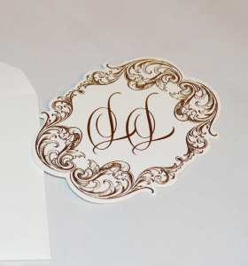 Close up on a foil stamped and die cut monogram tag.