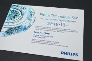 Letterpress plus a holographic foil save the date card