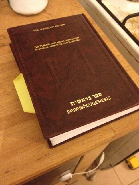 Like this one. This is the book of Genesis, with English translation and rabbinic commentary.