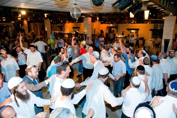 At Orthodox weddings, men and women dance separately. Jews traditionally dance in circles, like this.