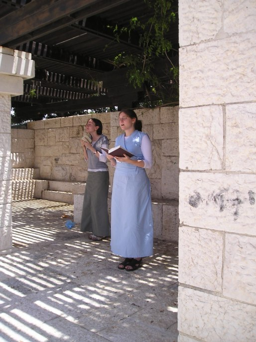 Me praying the afternoon prayer on my wedding day, with Abi, who was my milavah. ;) This is on the promenade at Armon HaNatziv, overlooking the Old City of Jerusalem.