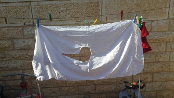Photograph of tallit katan on clothesline