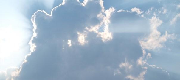 illustrative photo of light bursting through clouds