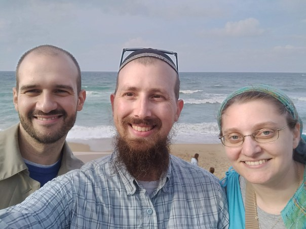 photo of Josep, Eitan, and Daniella in front of the beach