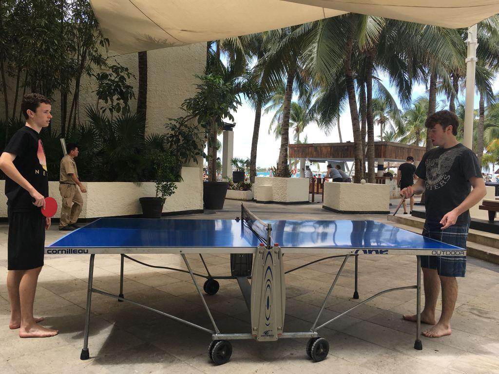 Boys playing ping pong at cancun mexico resort