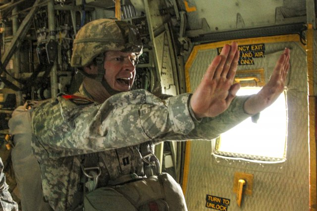 Jumpmaster giving commands to paratroopers before the door is opened.