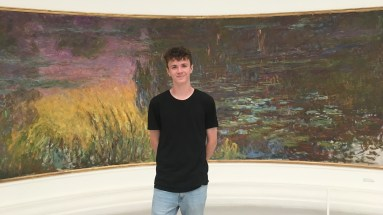 Riley in front of Monet painting