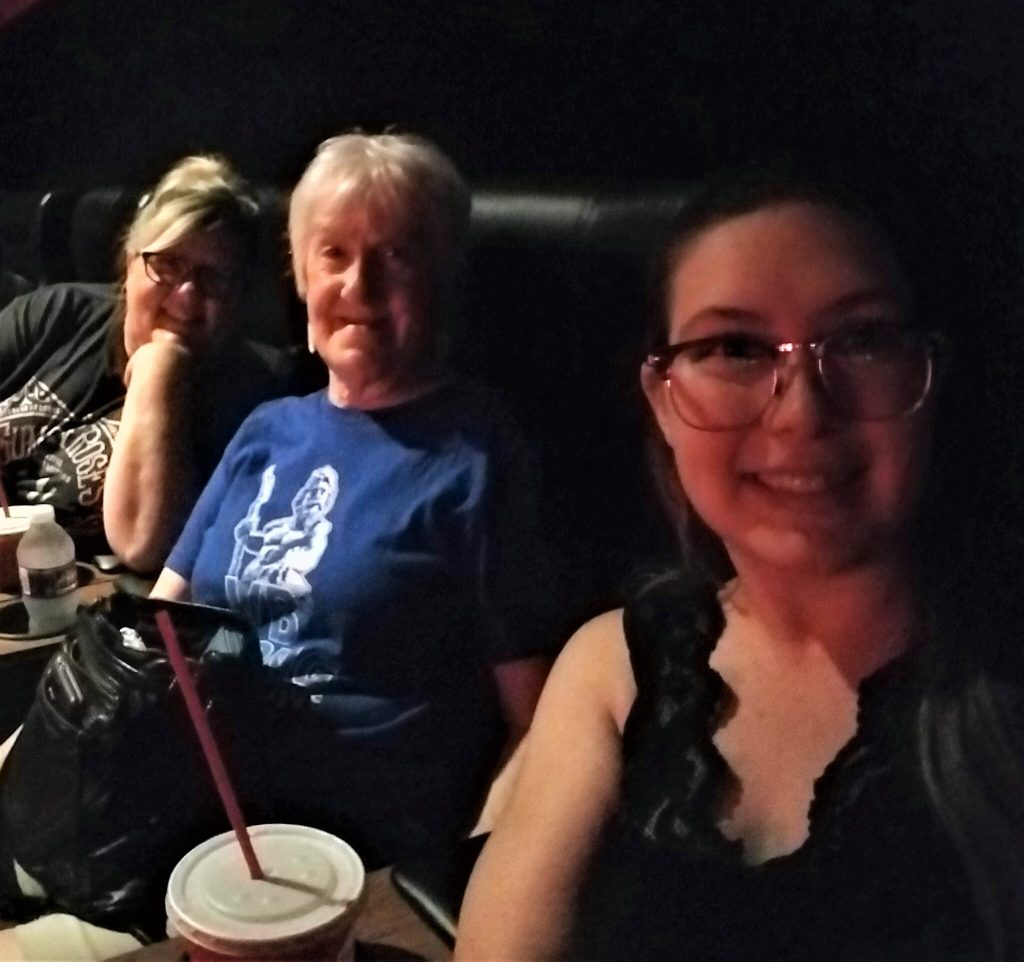 Kim, mom, and Bre at the movies