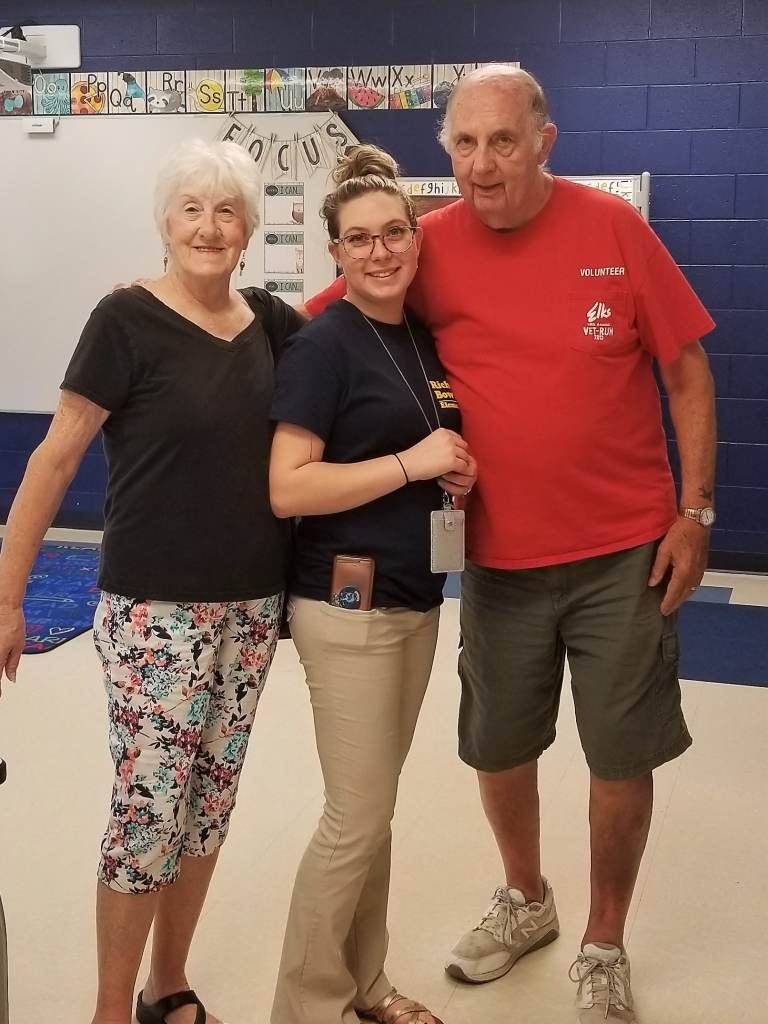 sissy, mom, and dad in her classroom