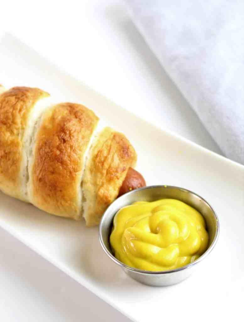 gluten free pretzel dog with mustard