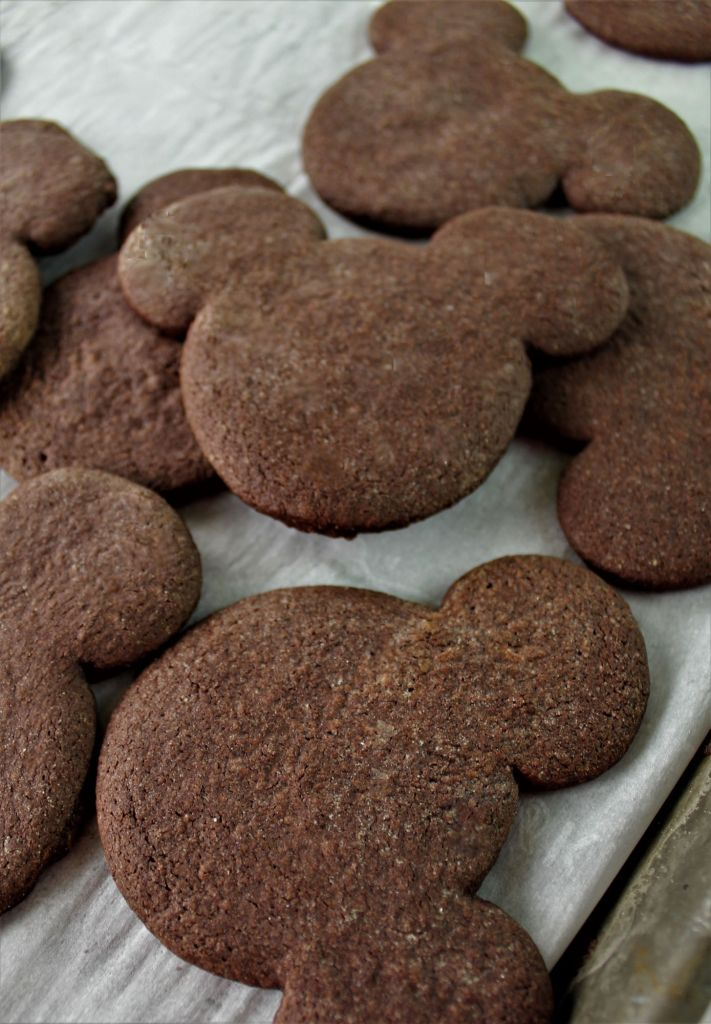 chocolate Mickey head cookies on a baking sheet