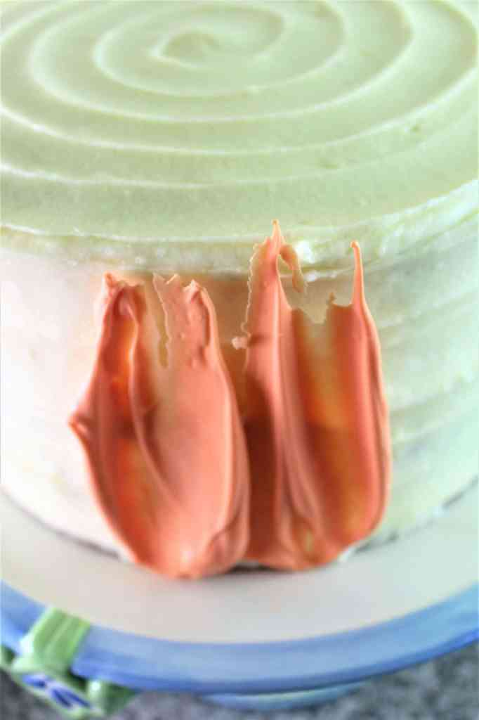 lining up two brush strokes on side of cake