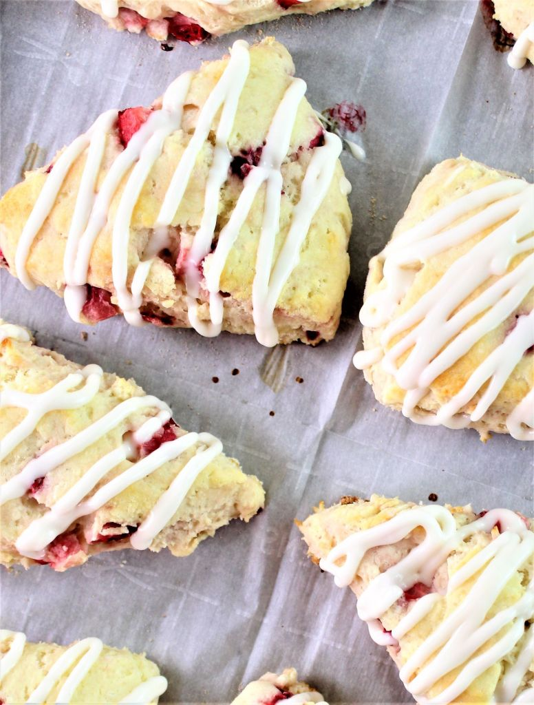 strawberry scones on parchment lined baking sheet