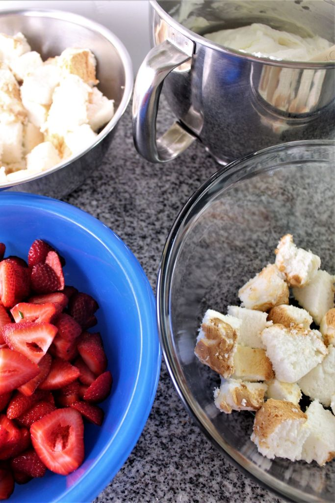 bowls full of strawberries, angel food cake cubes, and whipped cream cheese